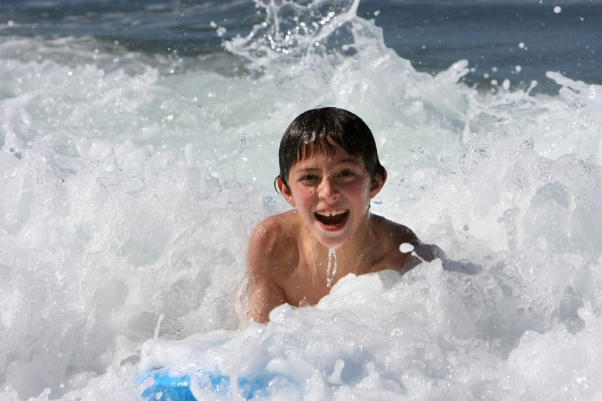 boy body surfing